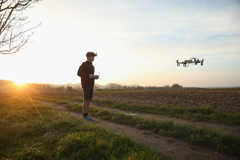 A Boy With A Quadcopter Drone