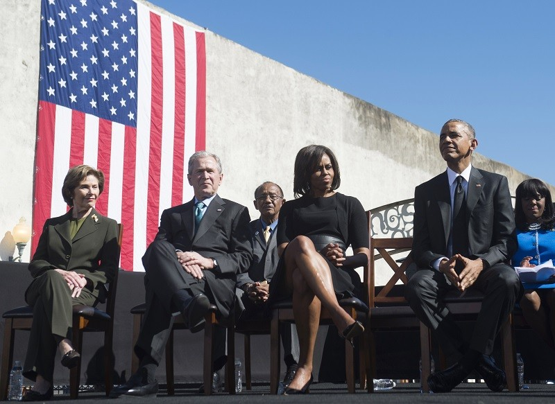 US President Barack Obama, First Lady Michelle Obama, former US President George W. Bush, and Laura Bush -- a real life red vs blue state, Democrats vs Republicans divide