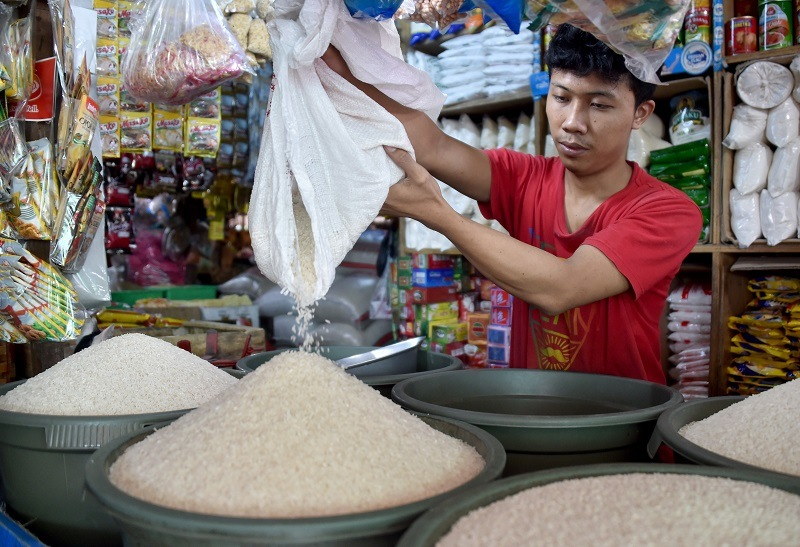 A man dumps rice into a bucket