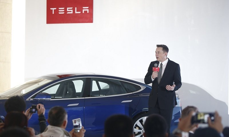 Elon Musk, Chairman, CEO and Product Architect of Tesla Motors, addresses a press conference to declare that the Tesla Motors releases v7.0 System in China on a limited basis for its Model S, which will enable self-driving features such as Autosteer for a select group of beta testers on October 23, 2015 in Beijing, China. The v7.0 system includes Autosteer, a new Autopilot feature. While it's not absolutely self-driving and the driver still need to hold the steering wheel and be mindful of road conditions and surrounding traffic when using Autosteer. When set to the new Autosteer mode, graphics on the driver's display will show the path the Model S is following, post the current speed limit and indicate if a car is in front of the Tesla.