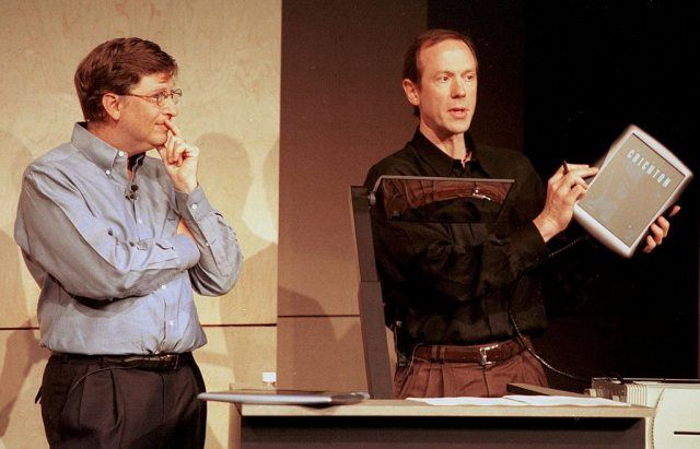 Microsoft Chairman Bill Gates (L) watches a demonstration of the Tablet PC by colleague Bert Kelly