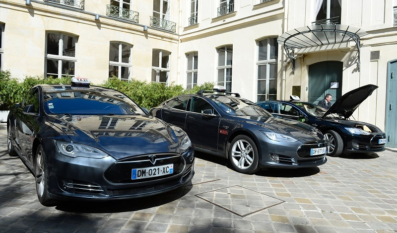 Electric Tesla taxis are presented during the launch of the initiative Taxis4SmartCities in Paris on April 14, 2016.