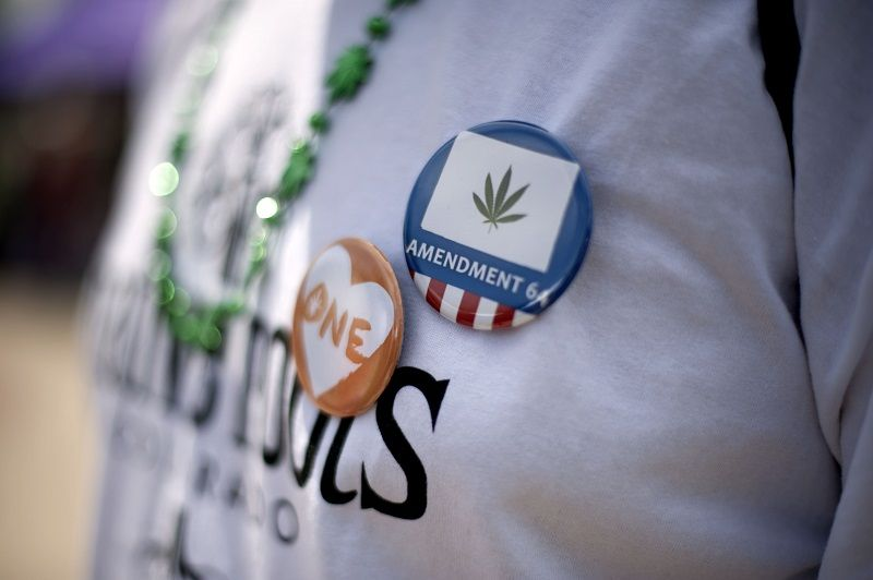 Pro-marijuana buttons are seen during the Denver 420 Rally