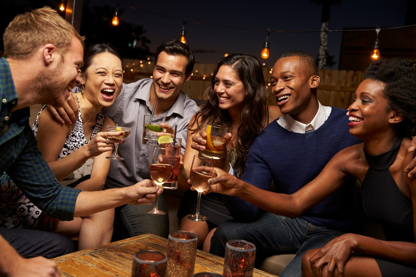 Friends at a bar, sharing career advice undoubtedly