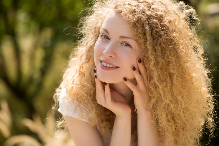 beautiful happy woman in a sunny day