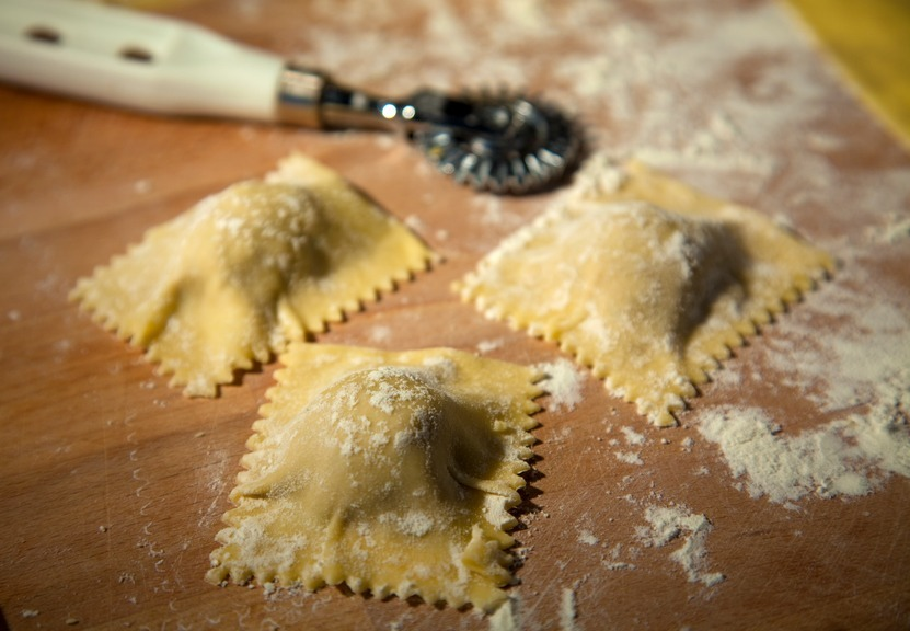 Homemade ravioli being cut