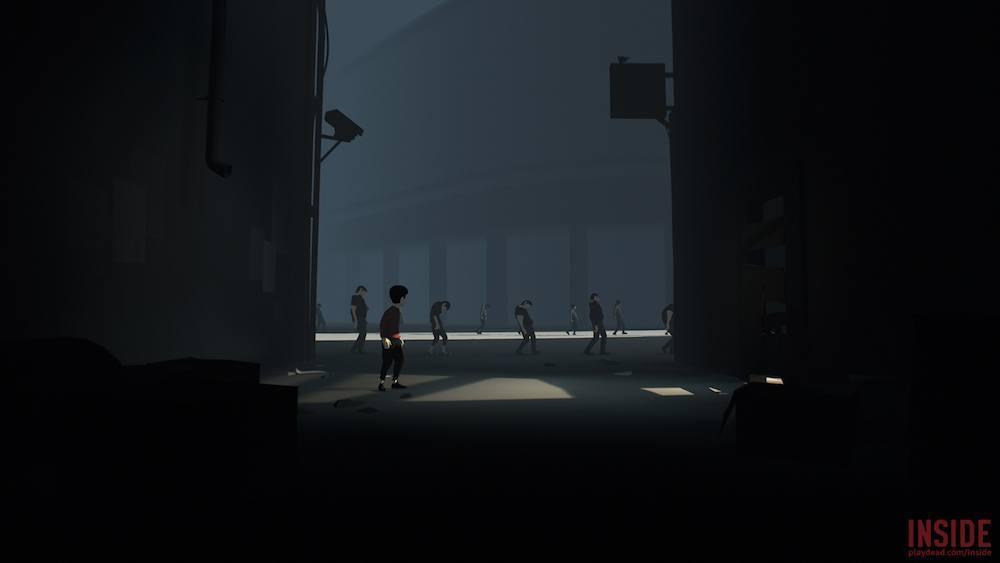 A boy sneaks through a facility.