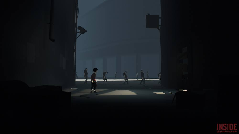 A boy sneaks through a facility.
