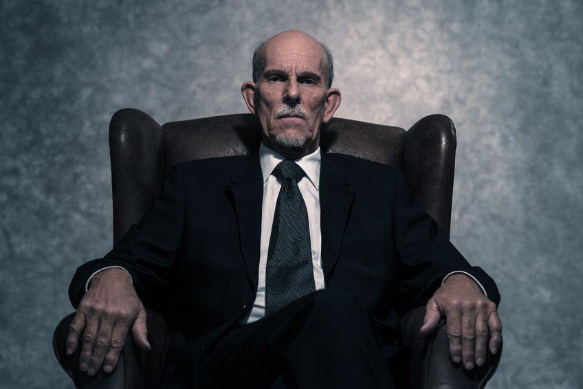 senior businessman sitting on a chair