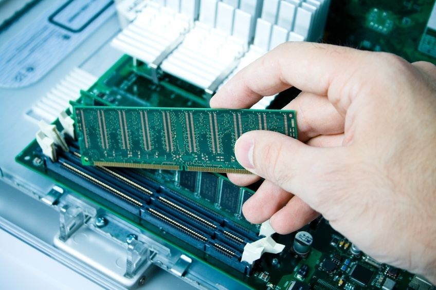 hand installing a ram in a PC