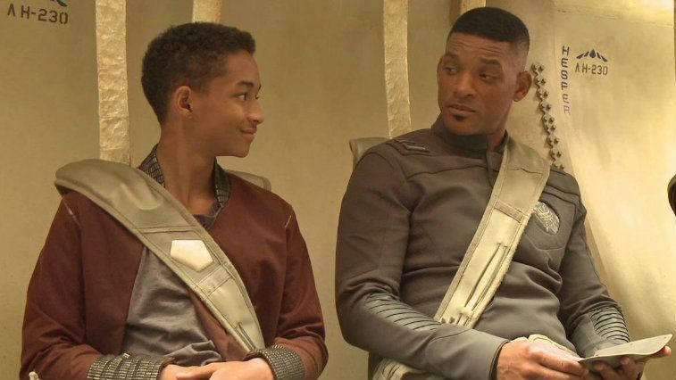 Jaden Smith and Will Smith look at each other as their strapped into seats in After Earth.