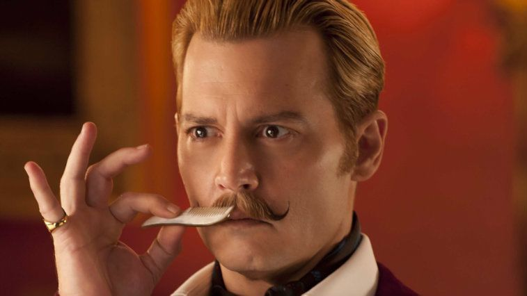 Johnny Depp combs his mustache in Mortdecai