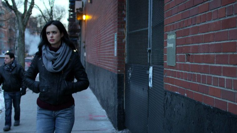 Krysten Ritter in a leather jacket, walking down the street