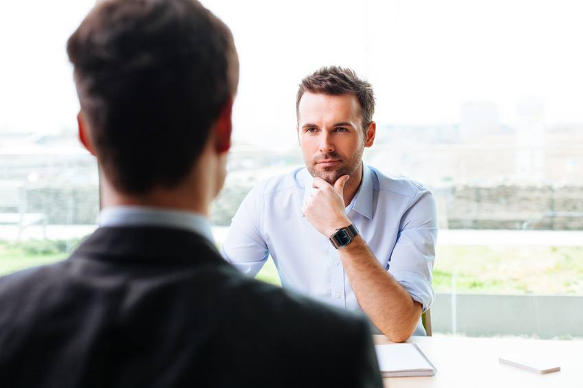 A manager meets with a consultant
