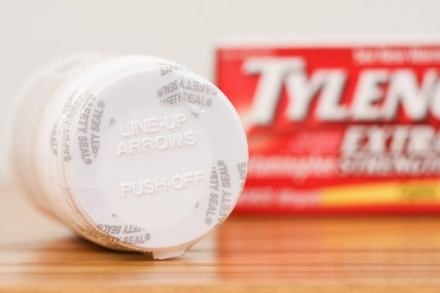 sealed bottle of Tylenol with the box in the background
