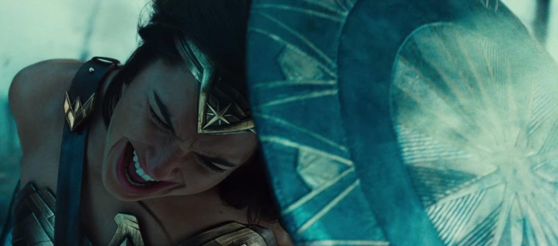 Wonder Woman blocking gunfire with her shield
