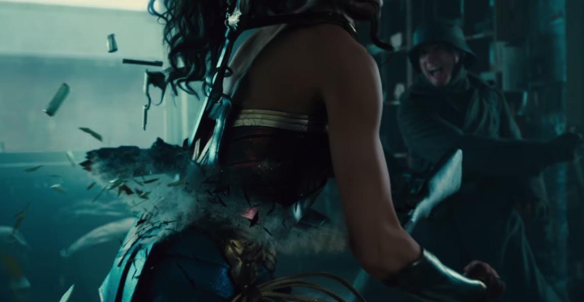 Wonder Woman breaks a rifle across her back