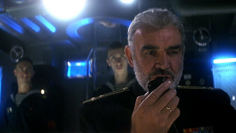 Sean Connery is talking into a walkie talkie in The Hunt for Red October