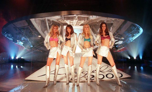 """NEW YORK, UNITED STATES: Supermodels (L-R) Daniela Pestova, Stephanie Seymour, Karen Mulder and Ines Rivero pose in front of a spaceship to celebrate the launch of Victoria's Secret """"Angels 2000"""" line of bras and panties. The new line is made of futuristic liquid-looking fabric. AFP PHOTO/Timothy Clary (Photo credit should read TIMOTHY A. CLARY/AFP/Getty Images)"""