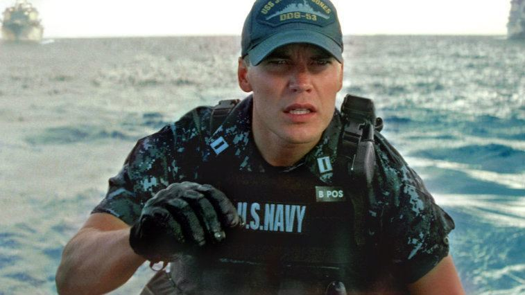 Taylor Kitsch stands in a navy uniform in Battleship