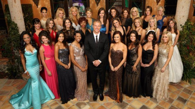 Contestants on 'The Bachelor' posing together in front of the house.