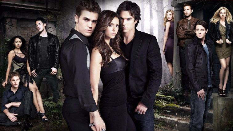 The cast of The Vampire Diaries standing outside
