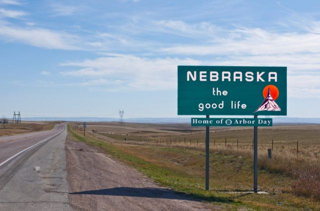 Nebraska sign board on a empty road
