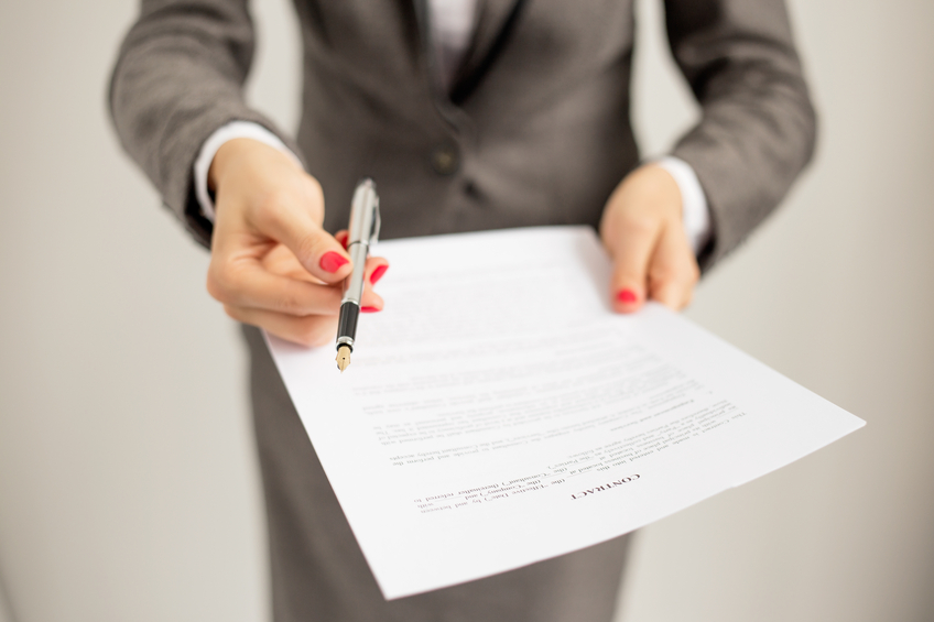 job offer, woman offering a contract and a pen