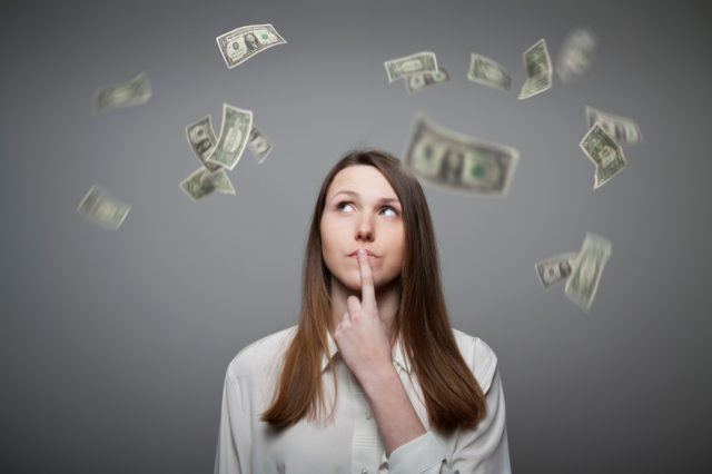 Young woman thinking about paying bills