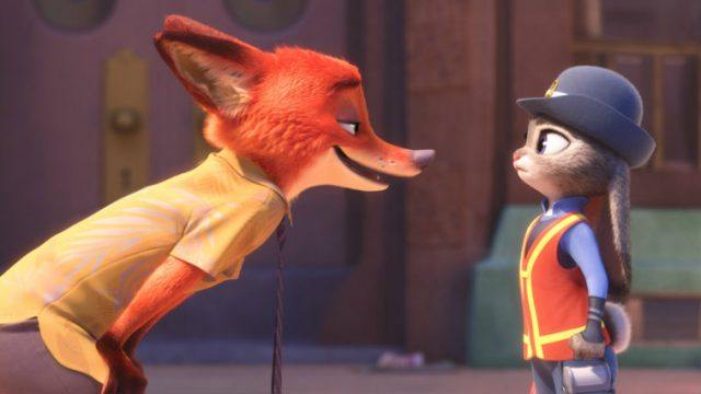 Nick bending down and talking to Judy.