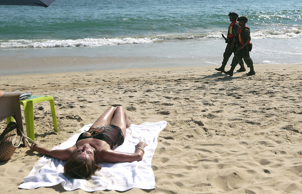soldiers on beach in acapulco