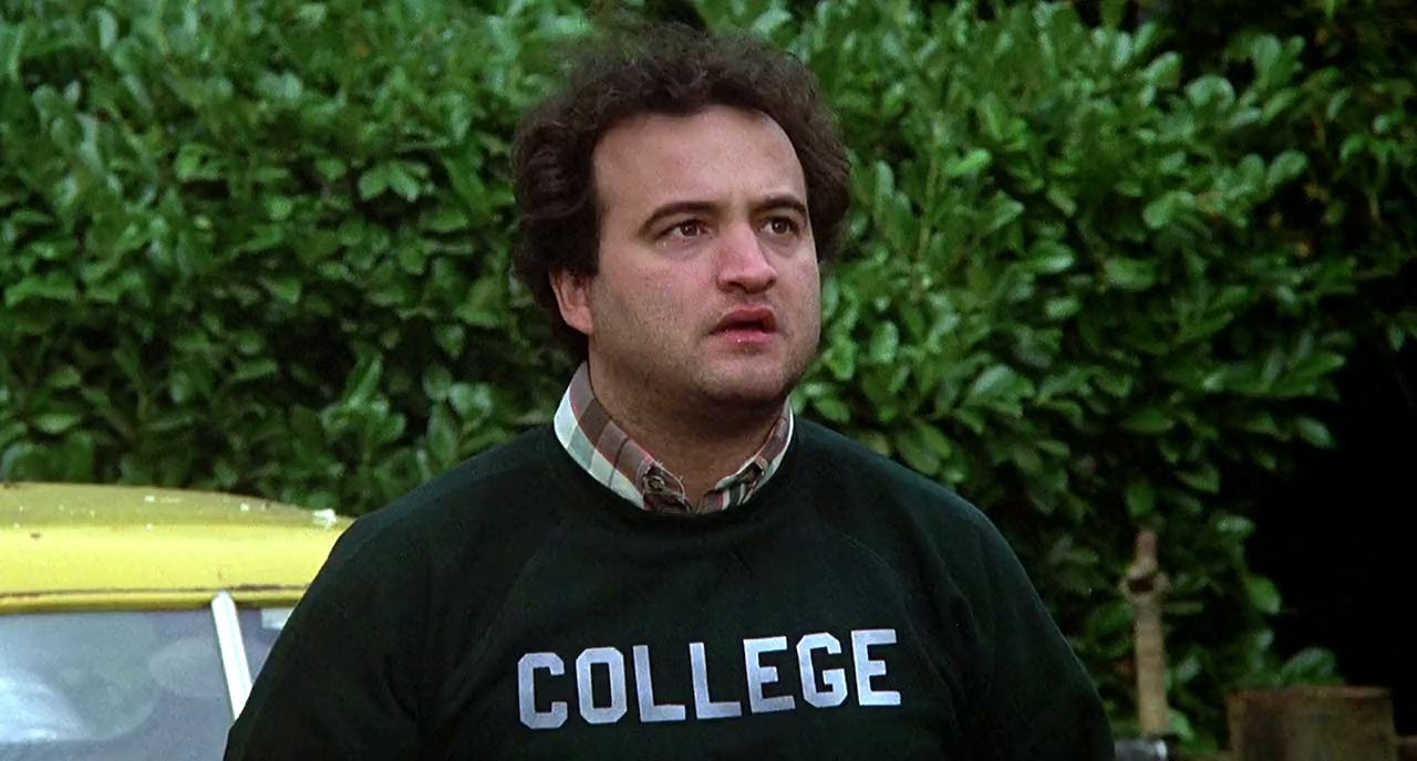 Fraternity brothers in front of the run down house in Animal House