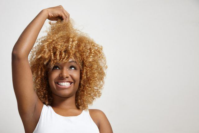 Woman looking at her hair