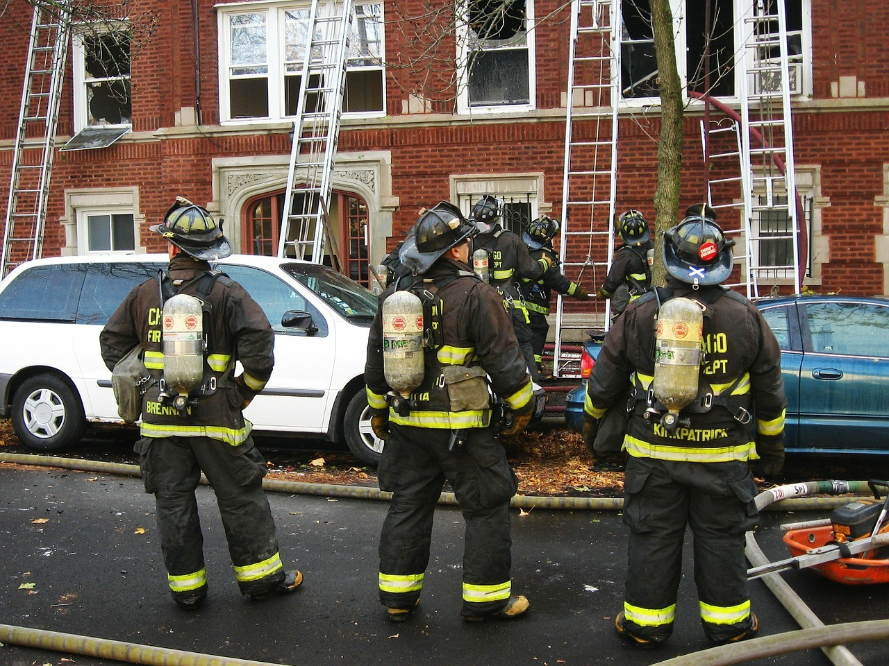 Firefighters outside a building