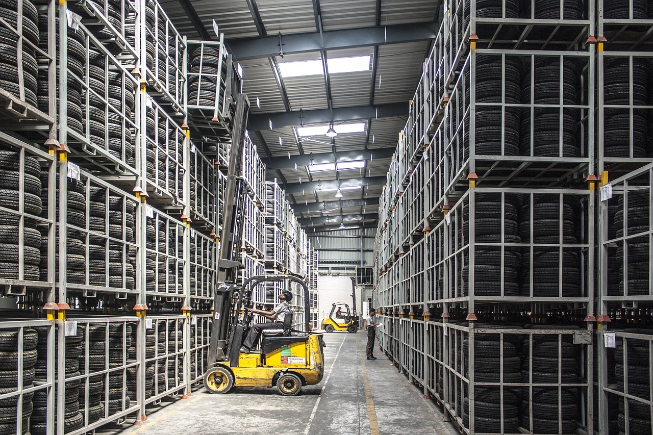 Man operates forklift in a warehouse