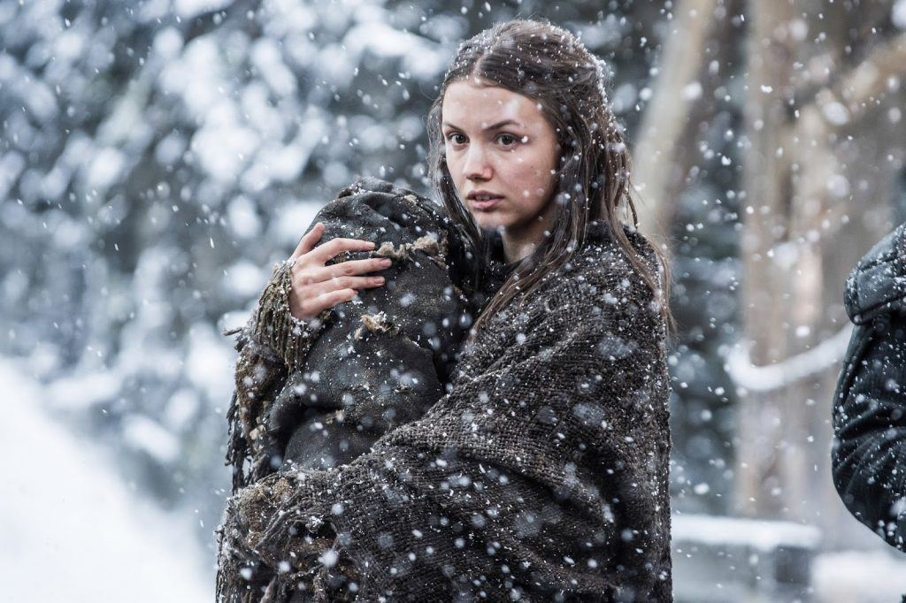 Gilly wrapped in a blanket as the snow falls down in Game of Thrones