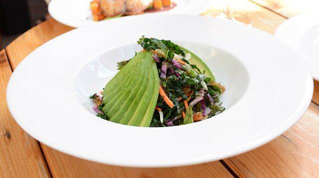 Kale salad with raisins and avocado at Haven Rooftop