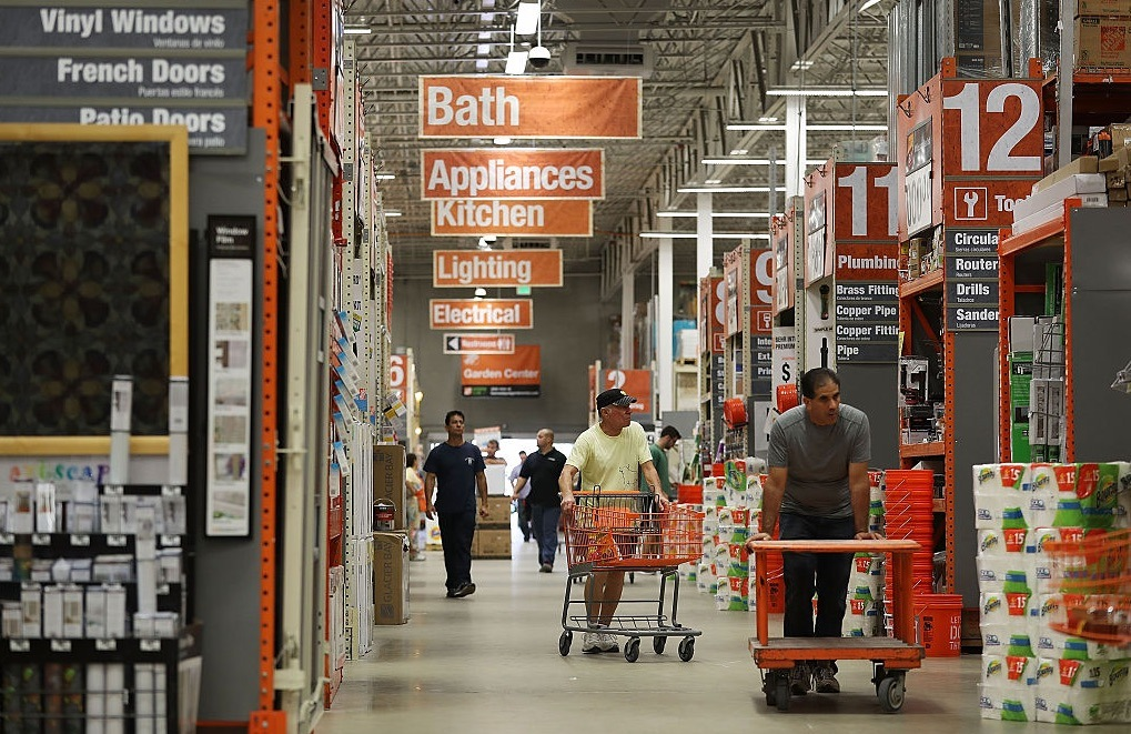 Customers shop at a Home Depot store