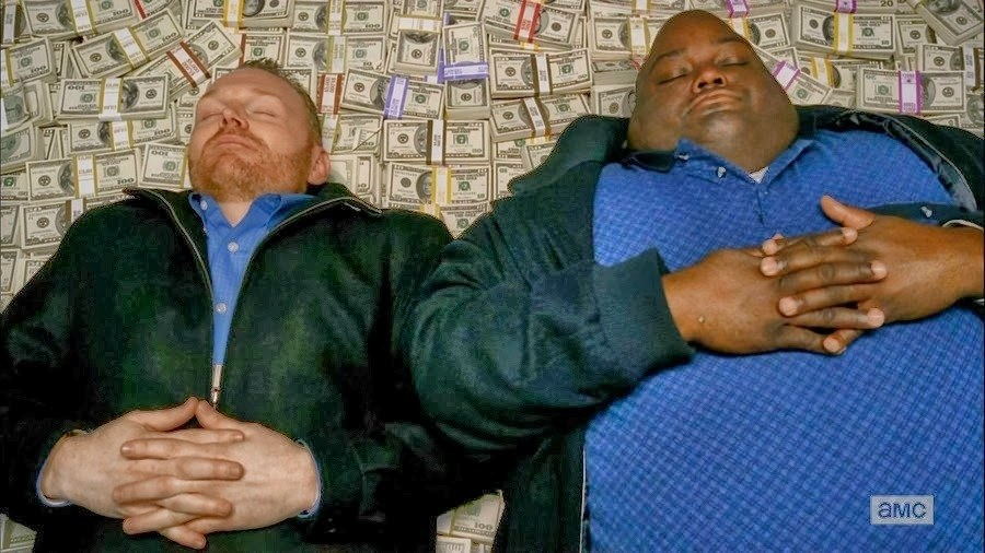 """""""Breaking Bad"""" characters lying on a pile of money."""