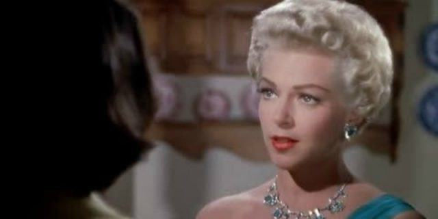 Lana Turner in a dress and diamonds on imitation of life