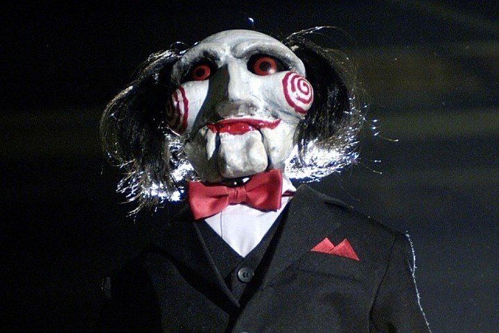 Jigsaw in Saw, smiling ominously and looking up