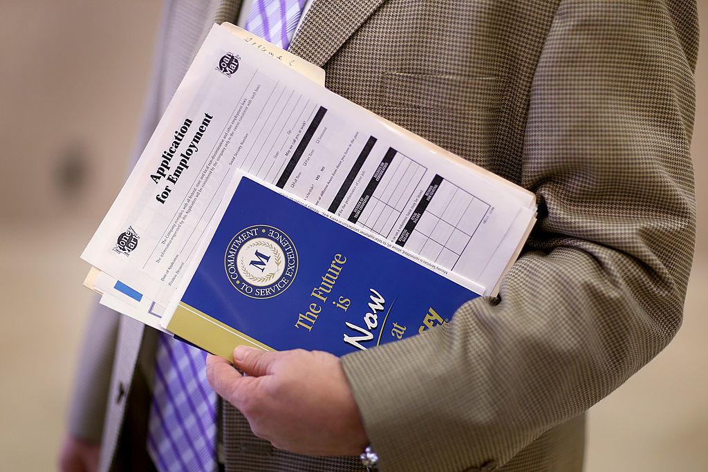 an unemployed man hold a job application