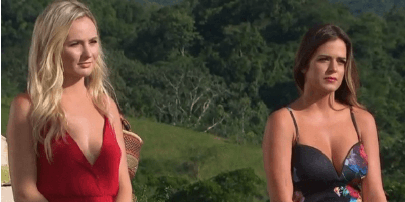 Jojo and Lauren are standing next to each other in a field on The Bachelor.