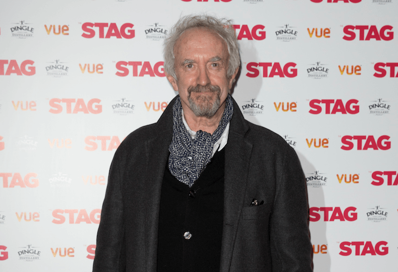 Jonathan Pryce poses for cameras at an event