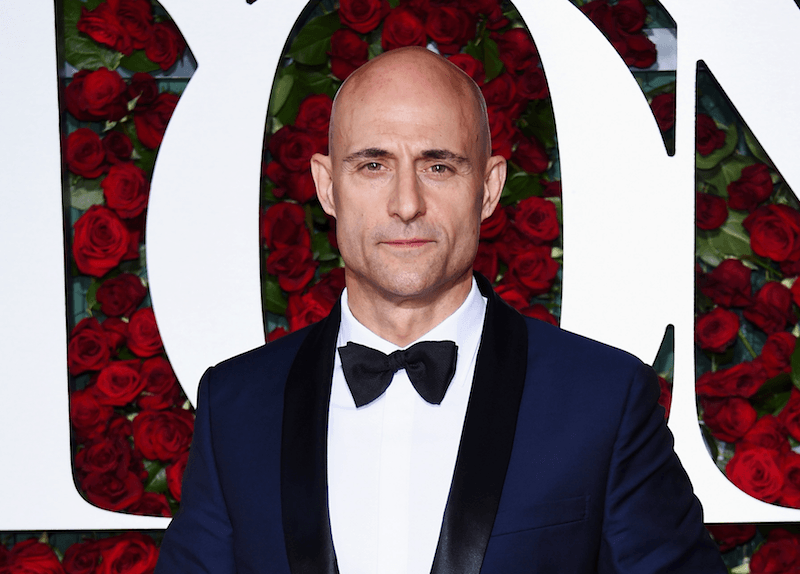 Mark Strong poses in a tux at a red carpet event
