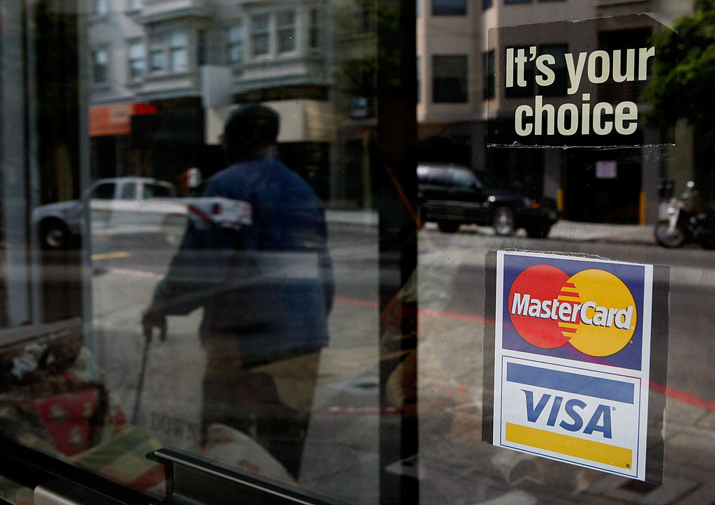 A sign advertising Visa and MasterCard credit cards