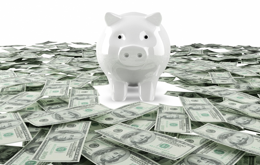 piggy bank with dollars surrounding it