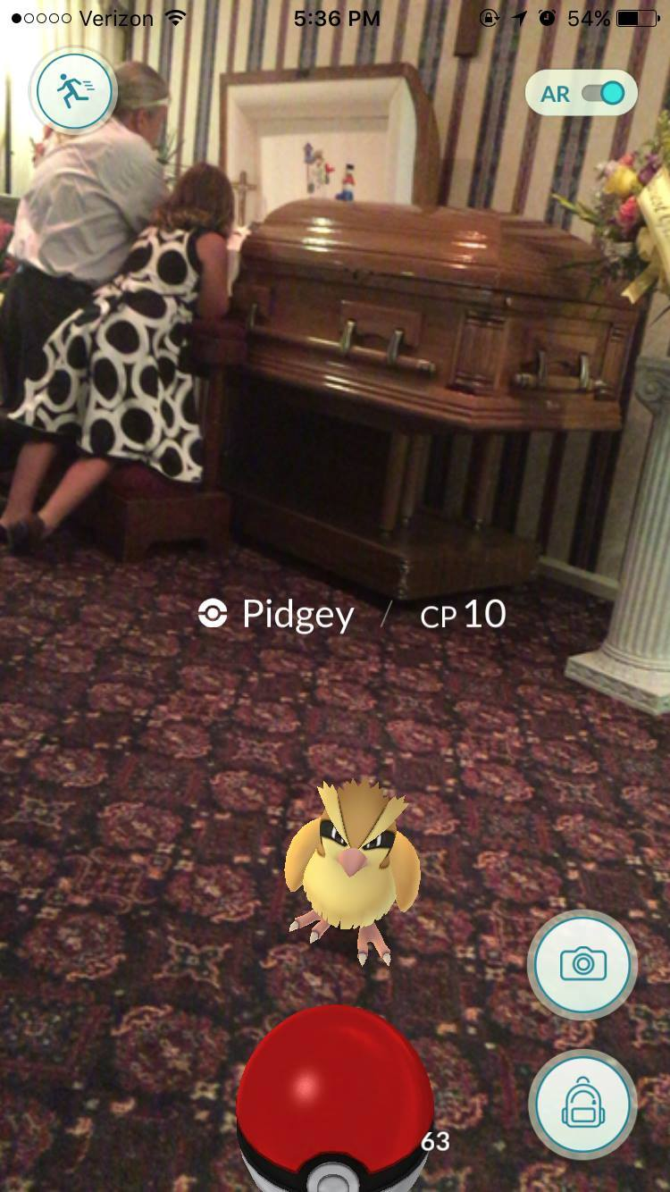 Pokemon Go at a funeral.