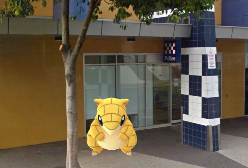 A Sandshrew Pokemon sits at a police station.