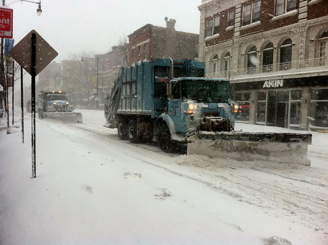 Snowplow on Chicago streets in blizzard